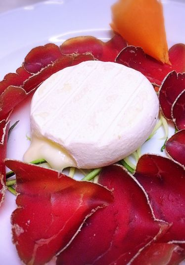 Appetizer with mocetta and cheese