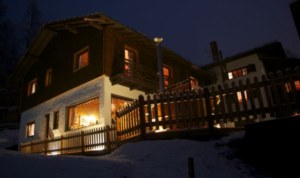 Hotel Villa Anna Maria illuminated at night with snow